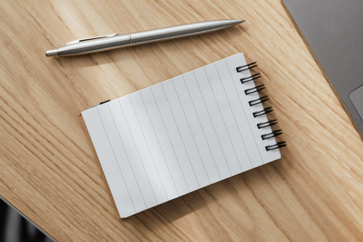 opened notebook and silver pen on desk